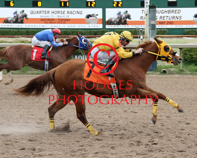 3/15/2014 Hemps Jumpn Lajolla with Raul Ramirez, Jr. up surges past Manuel Garcia aboard Party With Braxton to take the 8th running of the Mardi Gras Futurity at Louisiana Downs. Hodges Photography / Lynn Roberts