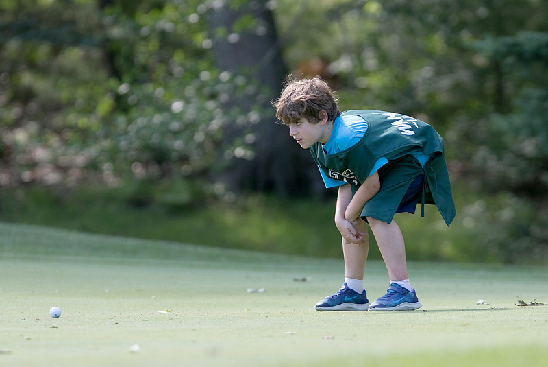The final round of the 94th annual Lowell City Golf Tournament was held at Mt. Pleasant Golf Club on Saturday, June 22, 2019. Caddy Alex Parigian, 8, looks over the seventh green for his dad golfer Doug Parigian during the tournament. SENTINEL & ENTERPRISE/JOHN LOVE