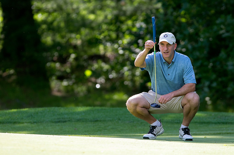 The final round of the 94th annual Lowell City Golf Tournament was held at Mt. Pleasant Golf Club on Saturday, June 22, 2019. Golfer Greg Hogan takes a good look at the Seventh hole green before he putt during the tournament. SENTINEL & ENTERPRISE/JOHN LOVE