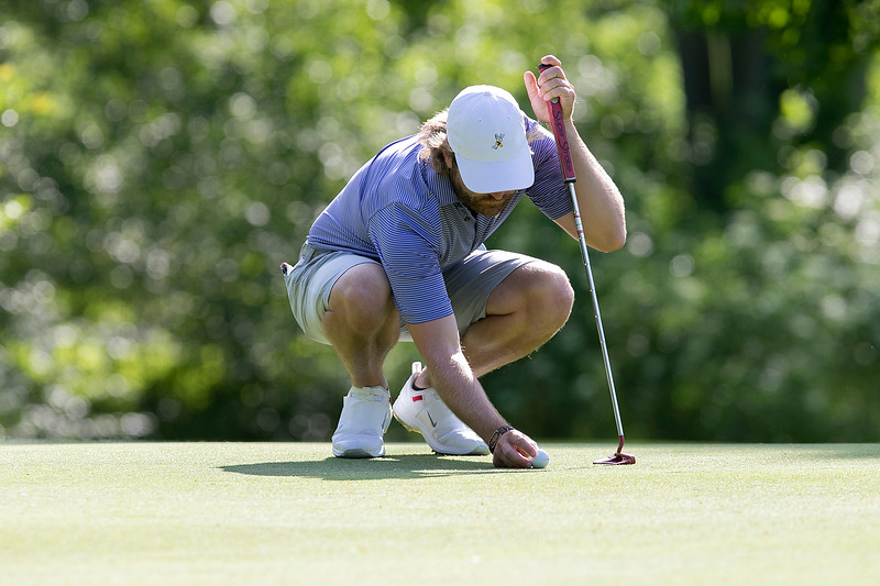 The final round of the 94th annual Lowell City Golf Tournament was held at Mt. Pleasant Golf Club on Saturday, June 22, 2019. Rich Campiola places his ball on the eighth green. SENTINEL & ENTERPRISE/JOHN LOVE