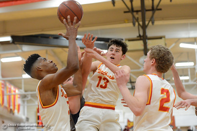 Left to right, Kaden Bradley, Ace Hindman, Ethan Hamel (13) and Brenden Bohannon (2) go for the rebound as Chico hosts Las Plumas on the basketball court Friday, Feb. 24, 2017, in Chico, California. (Dan Reidel -- Enterprise-Record)