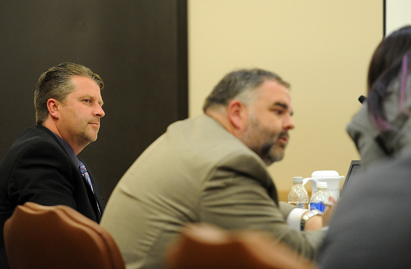 Loveland Police Detective Brain Koopman, left, listens as his defense attorneys David Goddard, center, and Jamie Wynn confer during his trail Wednesday, April 27, 2016, at the Larimer County Justice Center in Fort Collins. Koopman faces a charge of attempting to influence a public servant in connection with his investigation and prosecution of Leroy Wallace in a homicide case in 2013.  (Photo by Jenny Sparks/Loveland Reporter-Herald)