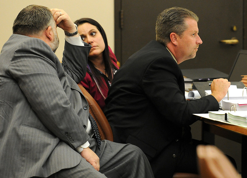 Defense attorneys David Goddard, left, and Jamie Wynn confer as Brian Koopman, right, watches the action in court Tuesday, April 26, 2016, during his trail for a charge of attempting to influence a public servant in connection with his investigation and prosecution of Leroy Wallace in a homicide case in 2013.  (Photo by Jenny Sparks/Loveland Reporter-Herald)