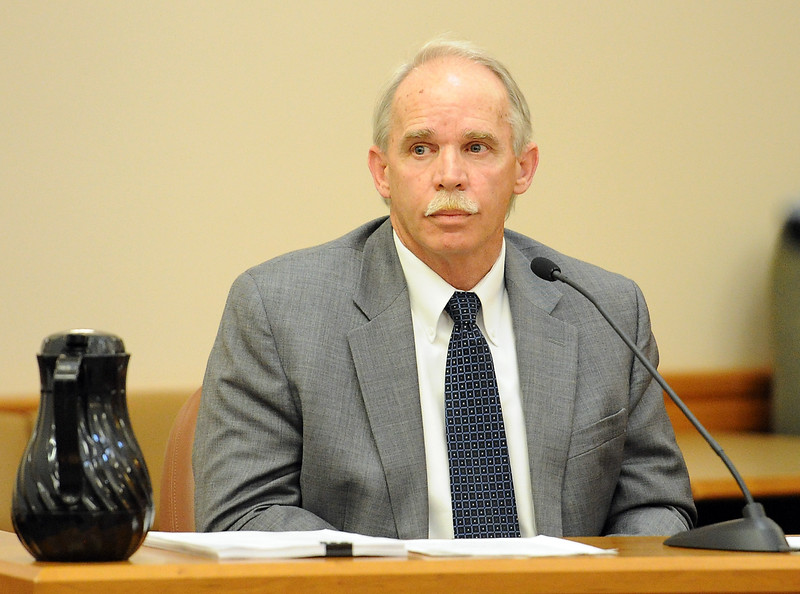 Weld County chief investigator Keith Olson testifies Tuesday, April 26, 2016, during a trail for Loveland Police Detective Brain Koopman, who faces a charge of attempting to influence a public servant in connection with his investigation and prosecution of Leroy Wallace in a homicide case in 2013.  (Photo by Jenny Sparks/Loveland Reporter-Herald)