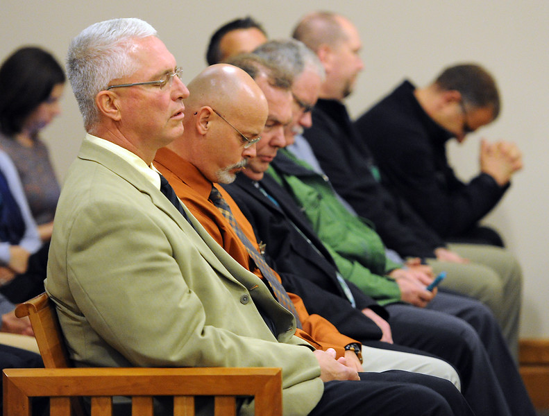 Former Loveland Police chief Luke Hecker and LPD detectives and officers await the verdict in the Brian Koopman trial Thursday, April 28, 2016, at the Larimer County Justice Center in Fort Collins. Koopman was acquitted on a charge alleging attempting to influence a public servant in connection with his investigation and prosecution of Leroy Wallace in a homicide case in 2013.  (Photo by Jenny Sparks/Loveland Reporter-Herald). (Photo by Jenny Sparks/Loveland Reporter-Herald)