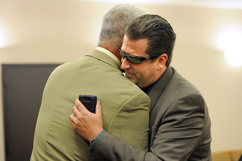 Loveland Police dectective Brain Koopman hugs former police chief Luke Hecker moments after a jury announced his acquittal on a charge alleging attempting to influence a public servant in connection with his investigation and prosecution of Leroy Wallace in a homicide case in 2013.  (Photo by Jenny Sparks/Loveland Reporter-Herald). (Photo by Jenny Sparks/Loveland Reporter-Herald)