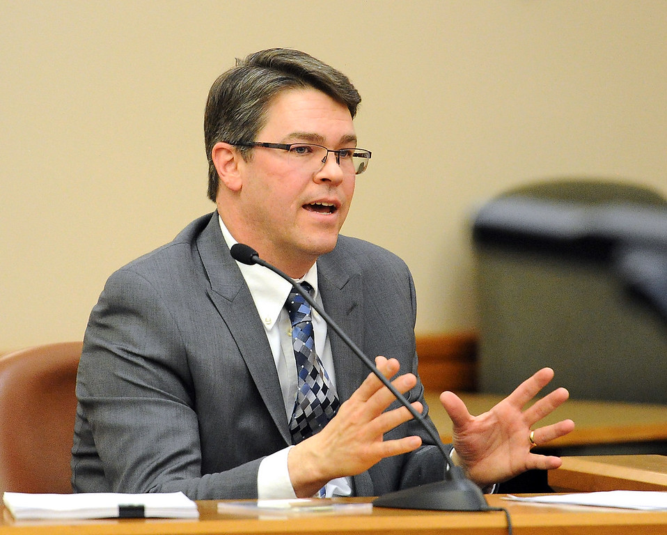 Andrew Lewis with the Larimer District Attorney's Office testifies Tuesday, April 26, 2016, during the trail for Loveland Police Detective Brain Koopman, who faces a charge of attempting to influence a public servant in connection with his investigation and prosecution of Leroy Wallace in a homicide case in 2013.  (Photo by Jenny Sparks/Loveland Reporter-Herald)