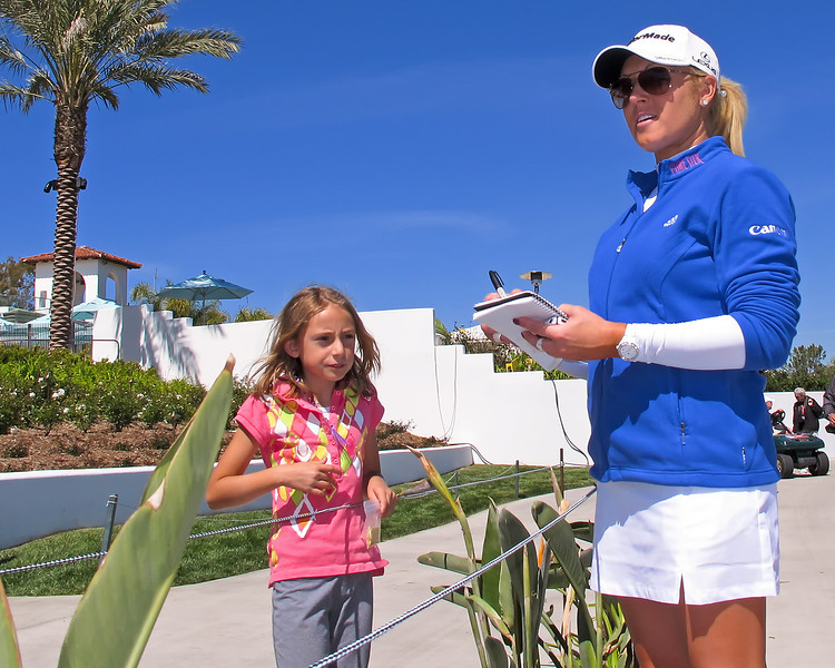21 MAR 12  Natalie Gulbis signs for a happy fan at Wednesdays Pro-Am at The KIA Classic at La Costa Resort and Spa in La Costa, California.