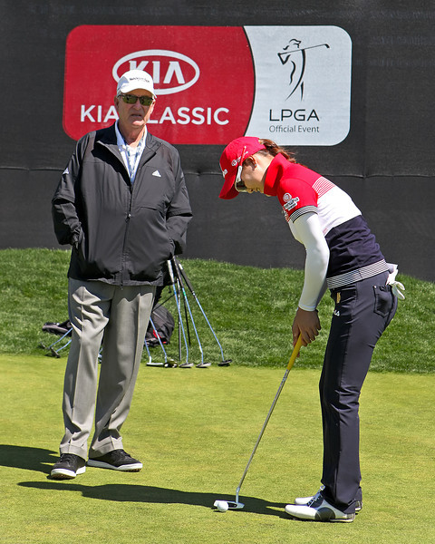21 MAR 12   So Yeon Ryu putts under the watchful eye of Dave Stockton after Wednesdays Pro-Am at The KIA Classic at La Costa Resort and Spa in La Costa, California.