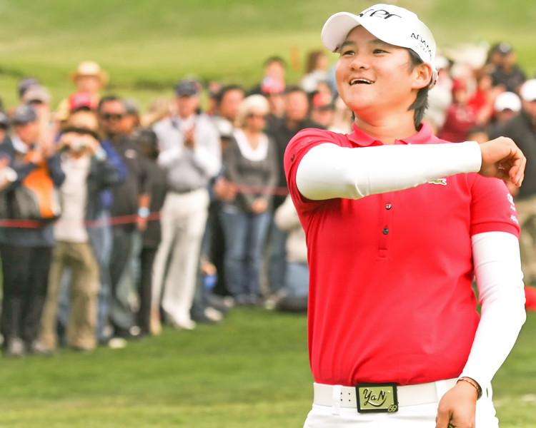 24 MAR 12 Yani Tseng throws the winning ball into the stands at the conclusion of Sundays Final Round of The KIA Classic at La Costa Resort and Spa in La Costa, California.