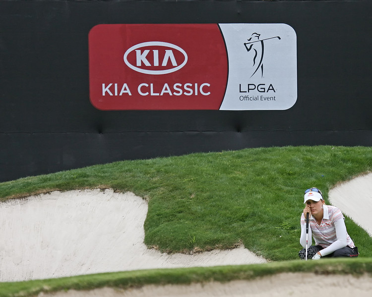 23 MAR 12   Lexi Thompson surveys her birdie putt from the valley behind the 18th green during Fridays  Second Round of The KIA Classic at La Costa Resort and Spa in La Costa, California.