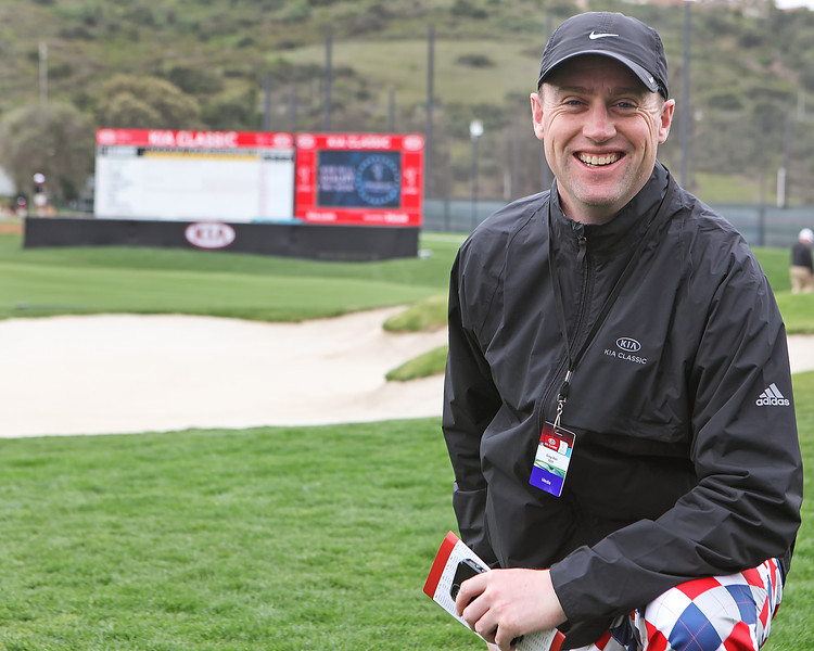 23 MAR 12 Media Executive Greg ball tries to hide his LoudMouth Pants as he pauses briefly in front of the 18th green at The Second Round of The KIA Classic at La Costa Resort and Spa in La Costa, California.