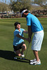 04 FEB 12 AJ Eathorne works with a student on the green in Scottsdale, Arizona.