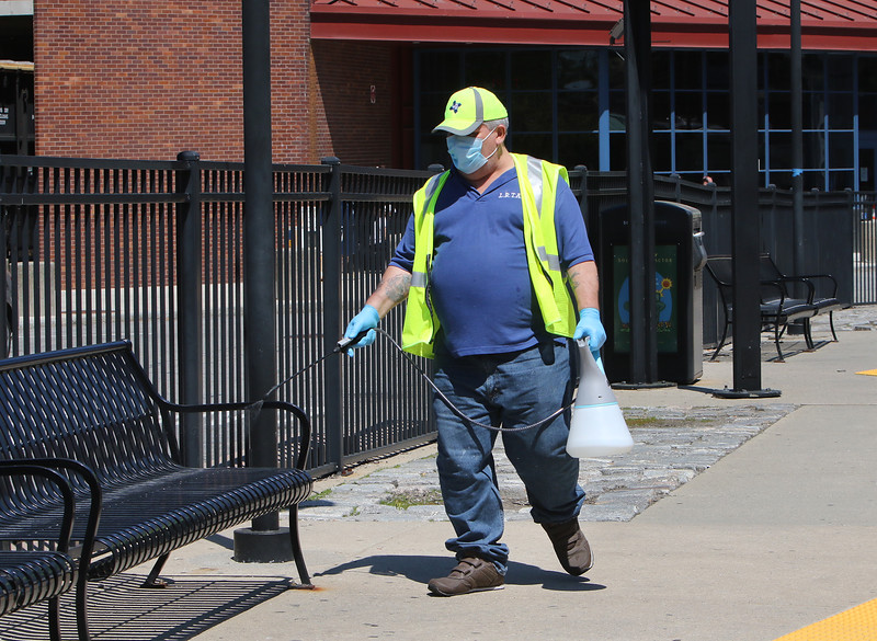 Mark Patten of Lowell, who works security, disinfects public areas at the Lowell Regional Transit Authority terminal in Lowell. LRTA has received a grant to help with COVID-19 related expenses and lost revenue. (SUN/Julia Malakie)