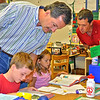 "David Waal, left, and Buddy Burke, both members of Lamorinda Sunrise Rotary, assist pupils at Springhill Elementary School in Lafayette look up words in the dictionaries given today [Sept. 3] to each of the roughly 300 children attending any of the four public grade schools in the city. First assignment: Look up the word ""service,"" something every Rotarian worldwide is familiar with. Education is one of the principal causes Rotary International is involved in. Another is the eradication of polio, which still plagues parts of Africa. [CREDIT Thomas Black]"