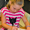 One of the 300 or so third-graders attending any of the four public elementary schools in Lafayette to receive today [Sept. 3] a personal copy of an American Heritage dictionary, compliments of Lamorinda Sunrise Rotary. [CREDIT Thomas Black]