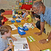 Thomas Peeks, president of Lamorinda Sunrise Rotary, offers assistance to pupil at Springhill Elementary School in Lafayette. The club handed out some 300 personal copies today [Sept. 3] to third-graders at each of the four public grade schools in the city. This marks the 13th consecutive year for the club to distribute -- at no charge -- personal copies to Lafayette schoolchildren. [CREDIT Thomas Black]