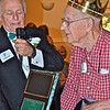 Fazel offers Thomas Deahl, 96, plaque honoring him as King (senior-most male).