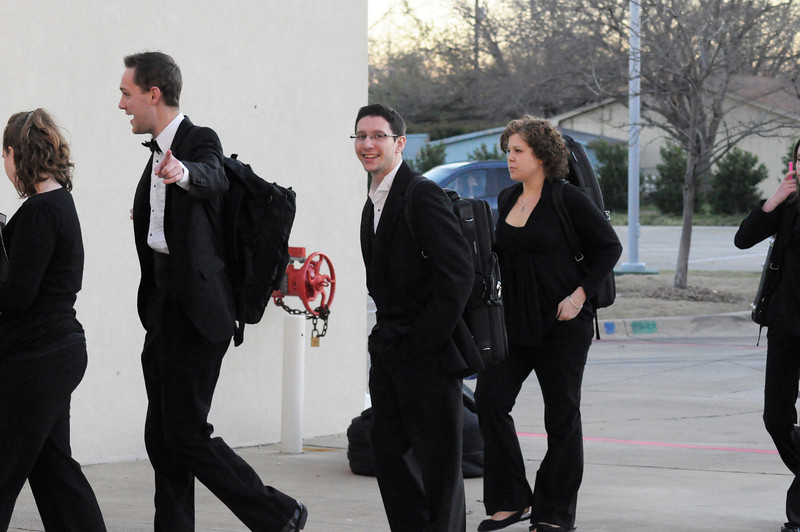 Members of the LSU Symphony Orchestra unload at the Mesquite Arts Center! <br /> <br /> The LSU Symphony Orchestra and Christopher O'Riley performed at the Mesquite Arts Center in Mesquite, Texas; February 25, 2012.   This image is the property of Louisiana State University and may not be used, reprinted or reproduced without the express written permission of the LSU College of Music & Dramatic Arts.