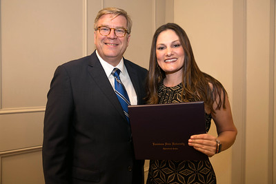 Virginia Buller of St. Landry Parish graduates from LSU AgLeadership Class XV. Presenting her graduation certificate is LSU AgLeadership coordinator Bobby Soileau, Ph.D.