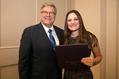 Virginia Buller of St. Landry Parish graduates from LSU AgLeadership Class XV. Presenting her graduation certificate is LSU AgLeadership coordinator Bobby Soileau, Ph.D.