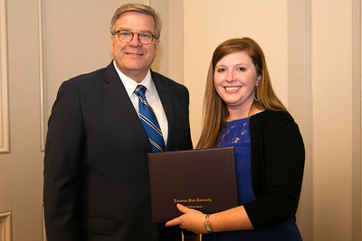 Kacie Luckett of East Baton Rouge Parish graduates from LSU AgLeadership Class XV. Presenting her graduation certificate is LSU AgLeadership coordinator Bobby Soileau, Ph.D.