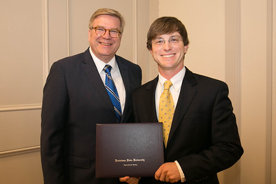 Stephen Simoneaux of Assumption Parish graduates from LSU AgLeadership Class XV. Presenting his graduation certificate is LSU AgLeadership coordinator Bobby Soileau, Ph.D.