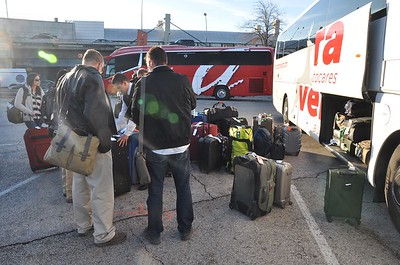 LSU Ag Leadership Class XV loads luggage onto the bus at the airport. The next stop is Hotel Agumar.