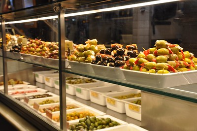 Olives of different varieties and prepared different ways for sale in the Mercado de San Miguel.