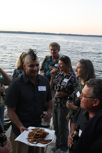 After the long afternoon trek from Madison to just south of Boulder Junction, Wisconsin, site reviewers gathered on the Trout Lake Station dock for an informal cocktail hour/fish fry.