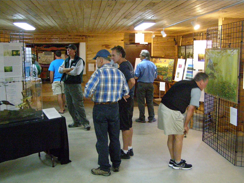 Site reviewers and hosts alike peruse the displays.