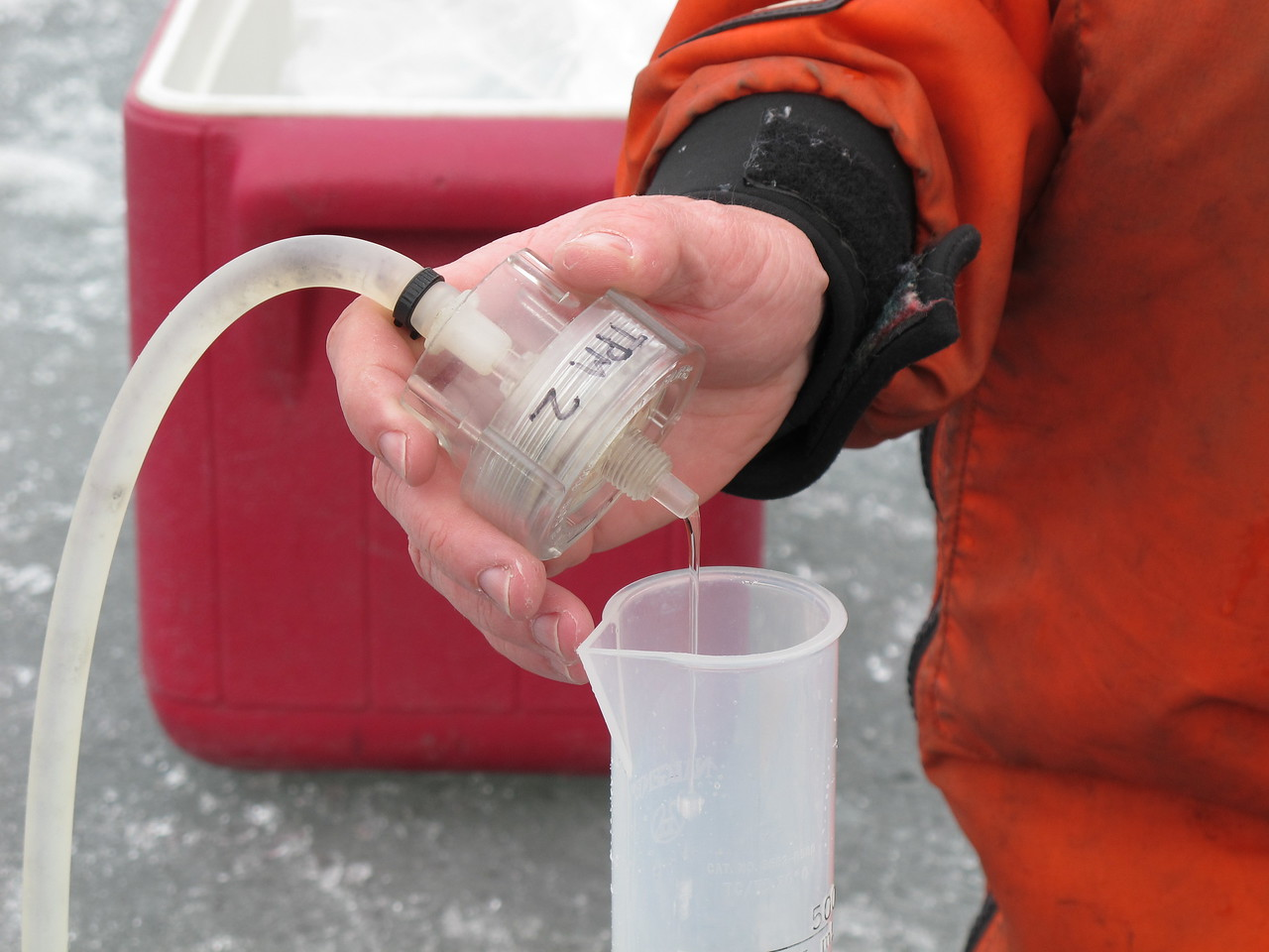 Again the sample is an outlier in the usual trend. Water runs through the filter until the filter clogs with particulate matter. That usually takes 5 to 8 milliliters of water during ice cover, Bier says. On this day it took 2.