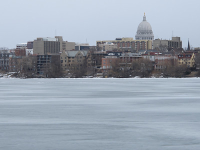 Winter in Wisconsin: The Madison skyline from the frozen surface of Lake Mendota.