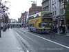 As Dublin Buses AV188 loads up on the 38A to Damastown tram 3013 crosses O'Connell St in the backround. Mon 25.09.06