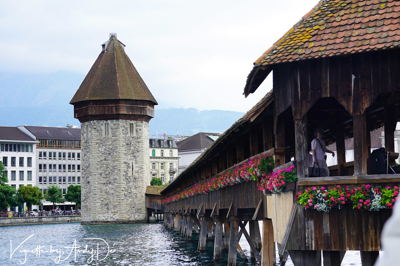The Chapel Bridge is flanked by the Water Tower which is another enduring and historical landmark of Lucerne.