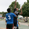 The LUK 20th Annual Common Ground Basketball Tournament was held on Saturday, August 10, 2019 at JoAnne Fitz Memorial Playground in Fitchburg. Mike Thompson puts up a shot while covered by Antonio Ware during the tournament. SENTINEL & ENTERPRISE/JOHN LOVE