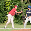 Shrewsbury Dirt Dogs pl;ayed the Lunenburg Phillies at Marshall Par in Lunenburg on Thursday night, July 25, 2019. Phillies pitcher Parker Bigelow delivers a pitch during the game. Phillies Joe Ruth tags Shrewsbury's Dylan Fenuccio as he tries to run to third. SENTINEL & ENTERPRISE/JOHN LOVE