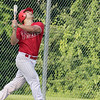 Shrewsbury Dirt Dogs pl;ayed the Lunenburg Phillies at Marshall Par in Lunenburg on Thursday night, July 25, 2019. Philles batter Nathan Ginsberg watches his popup during his at bat. SENTINEL & ENTERPRISE/JOHN LOVE