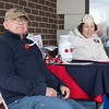 Joed Viera/Staff Photographer-Ron and Shirley Weaver brave the elements outside of Keybank on South Transit Road selling poppys for the VFW's Annual poppy drive. The drive continues today.