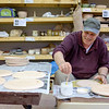 JOED VIERA/STAFF PHOTOGRAPHER-Lockport Art Company owner Russ Halstead works on a set of commissioned plates for Mile 303, a Medina restaurant slated to open soon. Halstead's business is located at 247 Market Street and offers of pottery classes almost daily. For more information visit Lockportart.com.