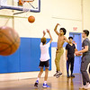 JOED VIERA/STAFF PHOTOGRAPHER-Lockport, NY-Kids play a shirts vs skins basketball game at the YMCA Wednesday evening.
