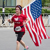 CONTRIBUTED/Cookie Butcher holds up Old Glory while running the Buffalo Marathon.