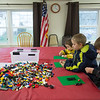 JOED VIERA/STAFF PHOTOGRAPHER-Remington, 5, Trever, 10, and Oliver Mietlowski, 8, take part in LEGO Club at the Royalton Hartland Community Library Wednesday afternoon.