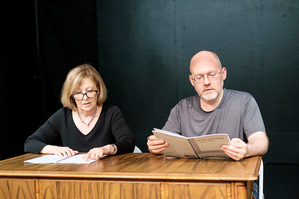 JOED VIERA/STAFF PHOTOGRAPHER-Lockport, NY-Kathleen Rooney and Geoff Koplas read from Love Letters, a play the pair are acting in at the Taylor Theatre.
