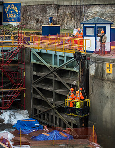 JOED VIERA/STAFF PHOTOGRAPHER-Lockport, NY-Canal Corp workers replace wooden beams on the gates of Lock 35 during their yearly winter maintanance operations.