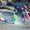 The first round of adults dive in the waters of Lake Ontario during the annual Polar Bear Swim for Sight on Sunday, March 5th, 2017 in Olcott, N.Y.(Joed Viera/Lockport Union-Sun & Journal)
