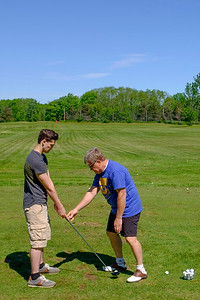 JOED VIERA/STAFF PHOTOGRAPHER-Lockport, NY-Doug Whelan, right, shows  Ellis Damon, 16, how to use a driver during the Lions Club's Diverse Students Golf Clinic at Willowbrook Golf Course.