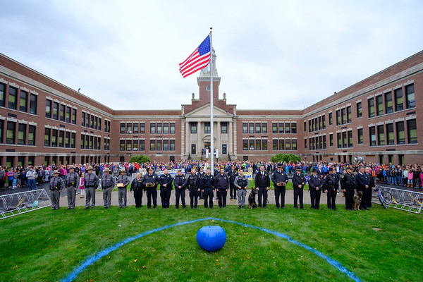 Joed Viera/Staff Photographer-Hundreds show to honor fallen Buffalo Police Officer Craig Lehner with flag raising ceremony at Emmet Belknap Monday morning.