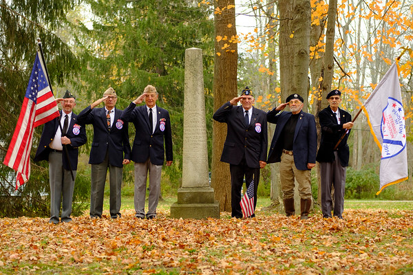 Joed Viera/Staff Photographer-Pendleton Veterans Association Honor Guard members  Gordy Bellinger, Tom Murray, Bill Rott, Bob Poth, Tom Ostrowski and Tom Burns salute by the grave of Sylvester Pendleton Clark.