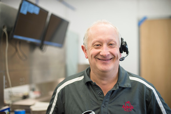 Joed Viera/Staff Photographer-James Graziano works the drive thru at Arby's on Transit Road. Graziano has been a manager at the sandwich shop for 33 years.